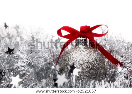 Christmas bauble decorations and holly - stock photo