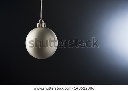 Christmas Bauble in simple color setting and side lighting - stock photo