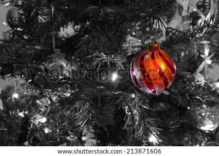 Christmas Bauble on a Christmas Tree - stock photo