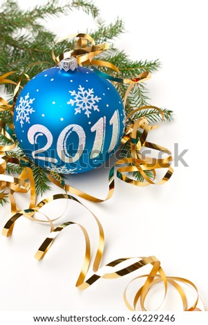 Christmas  bauble with number 2011, ribbons, and fir tree branches on white background - stock photo
