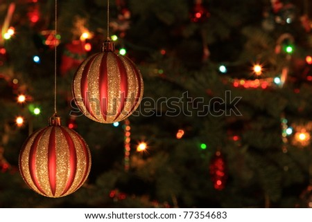Christmas Bauble with tree and lights on background - stock photo