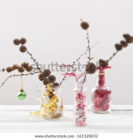 Christmas baubles and handmade decorations on white  - stock photo