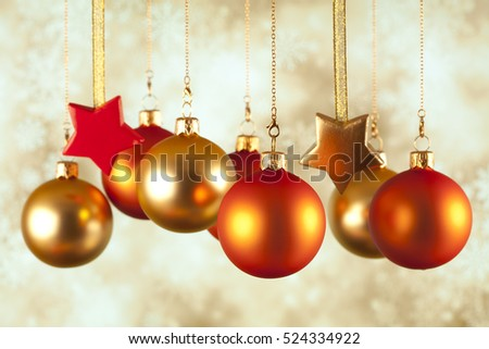 Christmas baubles and stars on abstract background