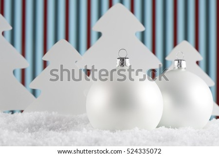 Christmas baubles and trees on snow and abstract background