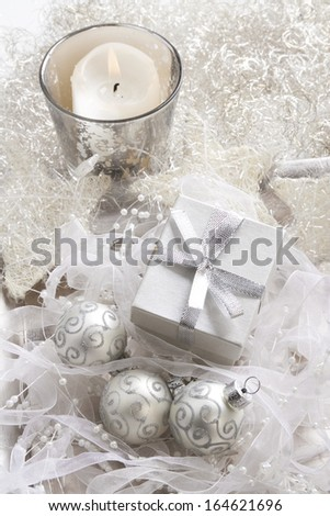 Christmas baubles, candle and gift box, background  - stock photo
