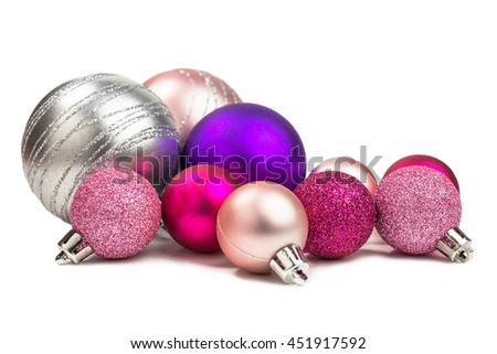 christmas baubles in different shades of pink and silver with glitter
