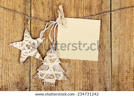 Christmas baubles in shape of Christmas tree and stars on wooden background    - stock photo