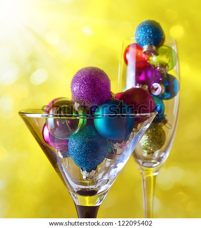 christmas baubles in wineglasses on a dark background. - stock photo