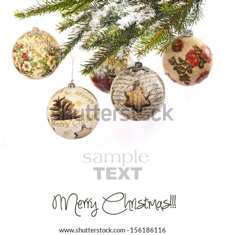 Christmas baubles made by technique decoupage on christmas tree  - stock photo