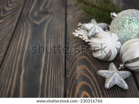 christmas baubles  on a rustic wooden background - stock photo