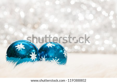 Christmas baubles on background of de ocused lights - stock photo
