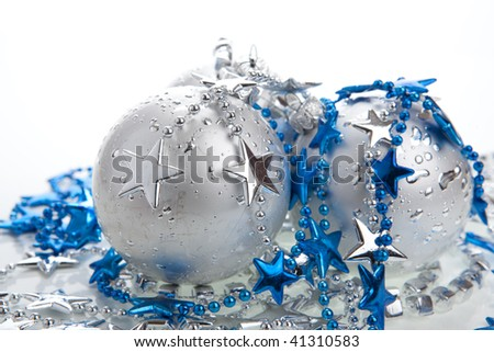 Christmas baubles with blue and silver decoration, isolated - stock photo