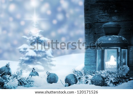 Christmas baubles with lantern snow and tree background blue concept