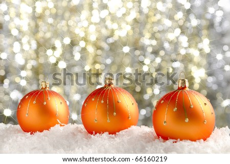 Christmas baubles with sparkling background - stock photo