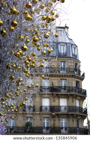 Christmas baubles with the building on the background, Paris, France - stock photo