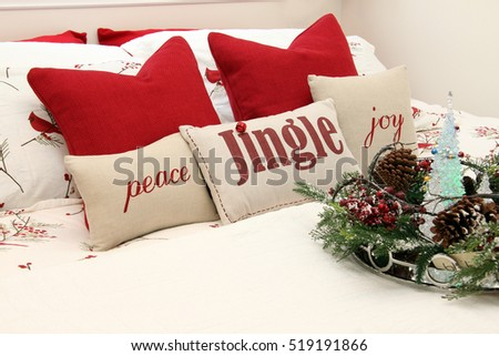 Christmas bedroom with holiday cushions.