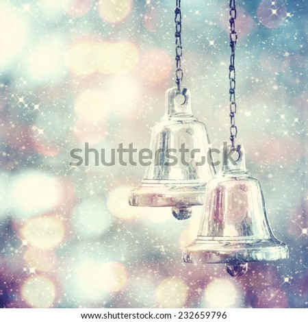 Christmas bells against defocused background - stock photo