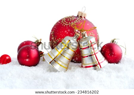 Christmas bells and decorations baubles on snow - stock photo