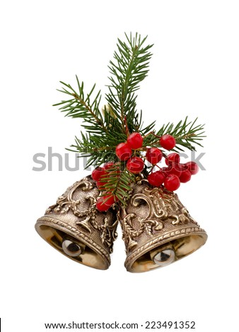 Christmas bells decorated with fir branches and berries isolated on a white background - stock photo