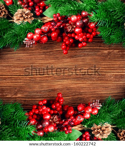 Christmas berries and spruce branch with cones - stock photo