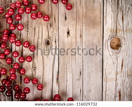 Christmas berries on aged wooden background - stock photo