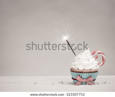 Christmas Birthday Cupcake with a sparkler - stock photo