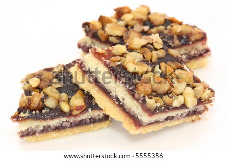 christmas biscuit with jelly and nuts  on white background