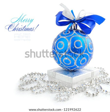 Christmas blue and silver decorations on white background - stock photo