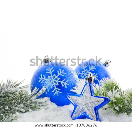 Christmas blue baubles and snowflakes isolated on white background with green fir and star - stock photo