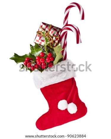 christmas boot stocking with gifts on white background - stock photo