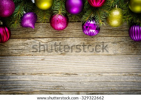Christmas border design on a rustic wooden board, copy space for text, top view.