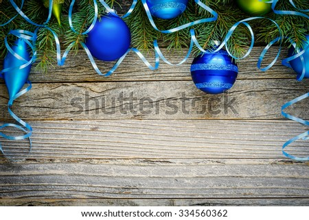 Christmas border design with Christmas decorations on a wooden background, copy space for text, top view.