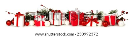 Christmas border of branches and red and white gifts over a white background - stock photo