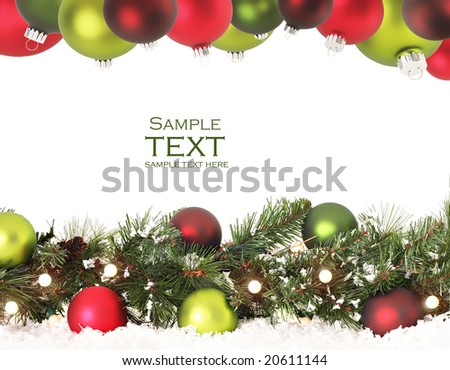Christmas border of evergreen, ornaments, lights and snow. - stock photo