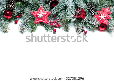 Christmas Border. Tree branches with baubles, stars, snowflakes isolated on white - stock photo