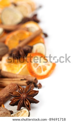 Christmas border with Christmas spices and dried orange slices isolated on white background - stock photo
