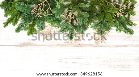 Christmas border with golden decorations on wooden background. Winter holidays - stock photo