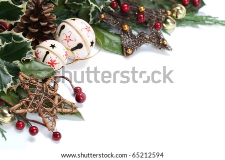 Christmas border with jingle bells, stars and other Christmas ornaments and decorations isolated on white. Shallow dof - stock photo