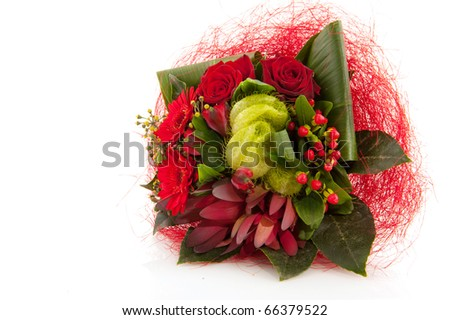 Christmas bouquet with mixed red flowers as roses and Gerber - stock photo