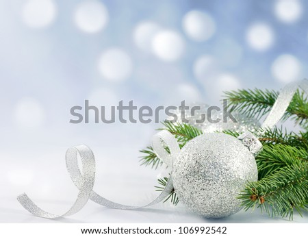Christmas branch of tree ribbon and bauble against snow background creative concept - stock photo