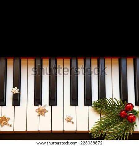 Christmas branch on piano keys - stock photo