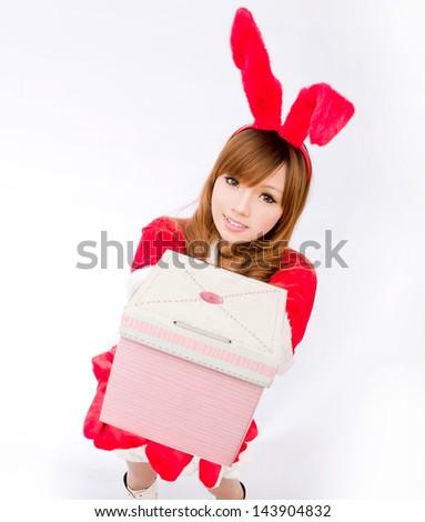 Christmas bunny  girl japanese style with gift box - stock photo