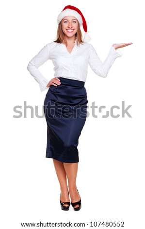 christmas businesswoman holding empty copyspace on her open palm. studio shot over white background
