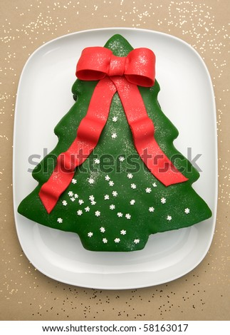 christmas cake in a shape of a christmas tree - stock photo