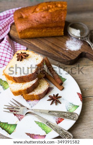 Christmas cake with anise star and cinnamon on the  christmas decorated plate - stock photo