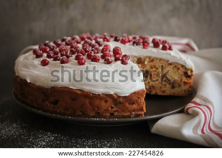 Christmas cake with cream and fresh berry - stock photo