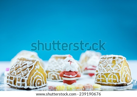 Christmas cake with simulation of a small village in winter season - stock photo