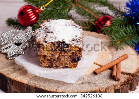 Christmas cake with spices and decorations, close-up, horizontal