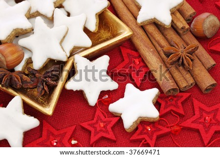 Christmas cakes on red tablecloth - stock photo