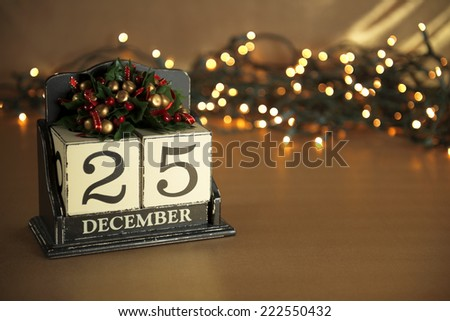 Christmas calendar with 25th December on wooden blocks  - stock photo